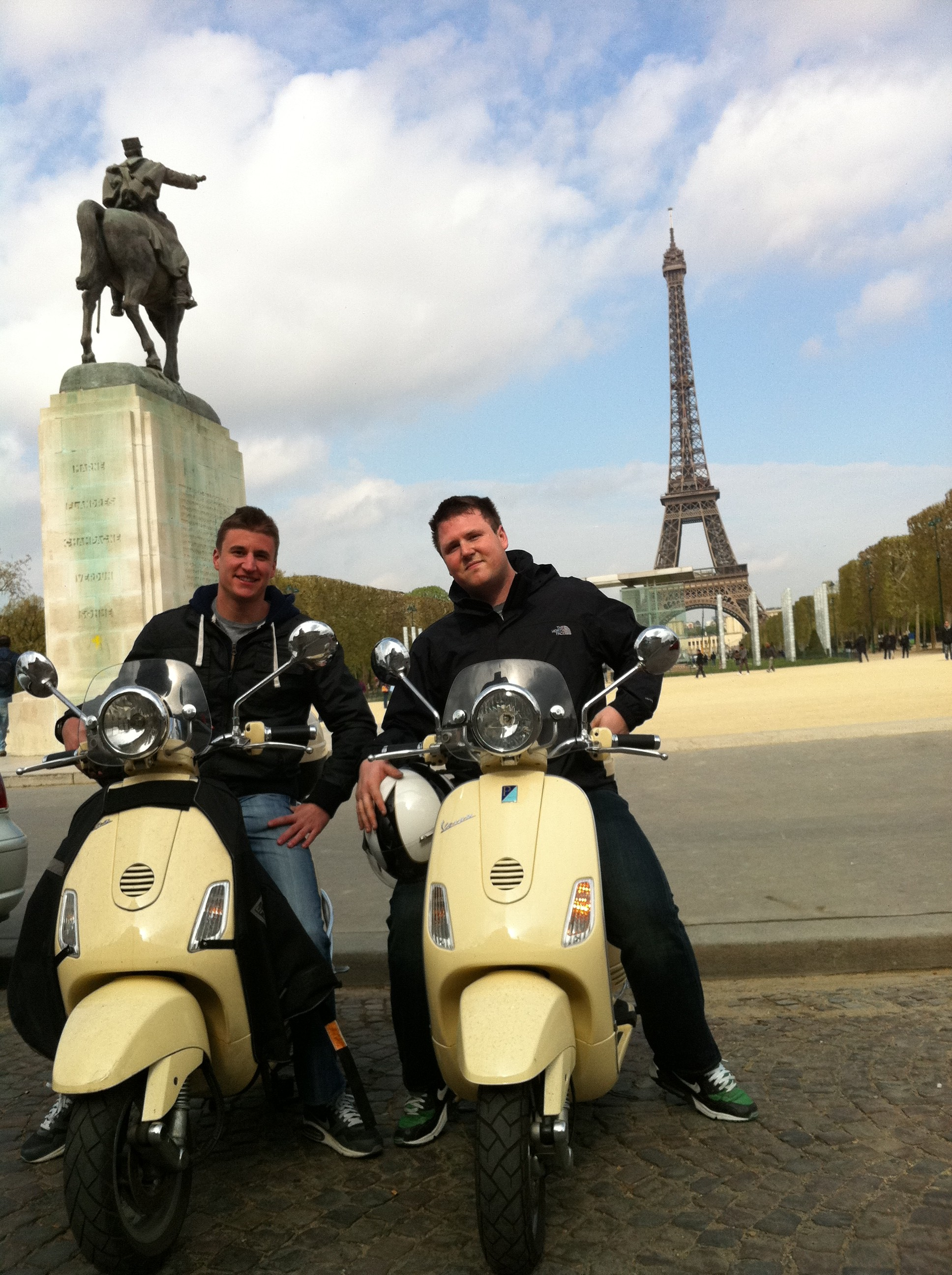 Pictures of paris france : the Eiffel Tower by Vespa scooter.