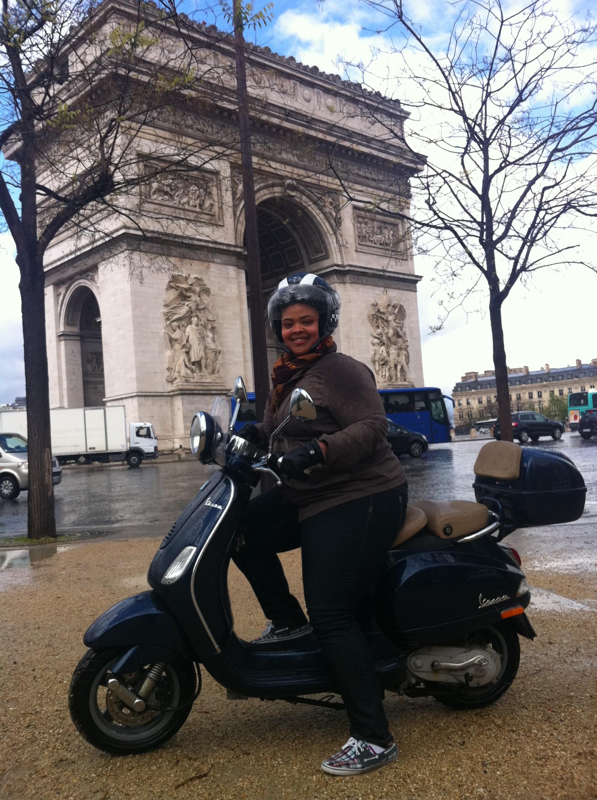 Arc de triomphe by vespa scooter - Paris France