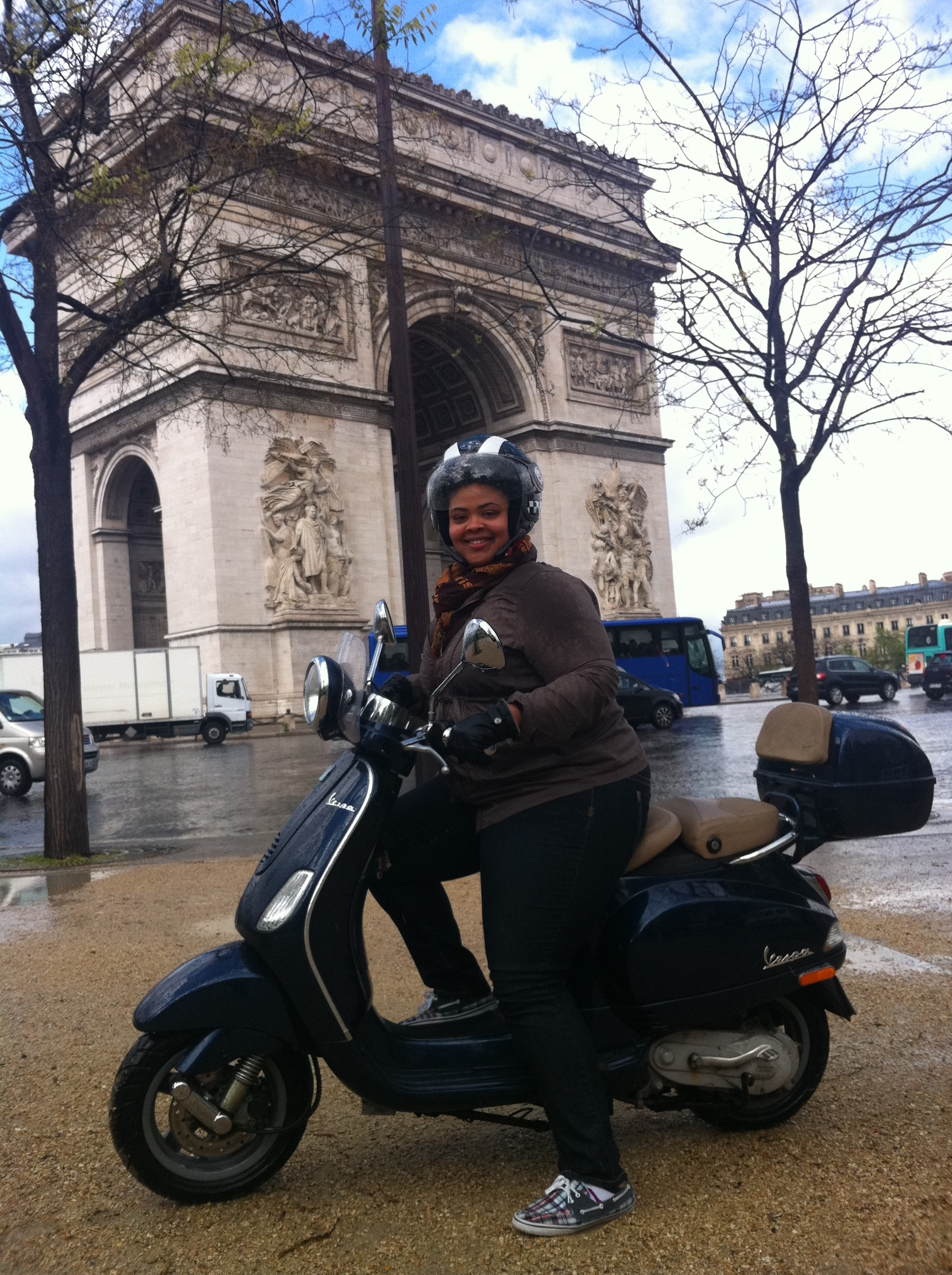 Arc de triomphe by vespa scooter - Paris France